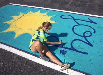 Students painting their parking spaces (copy)