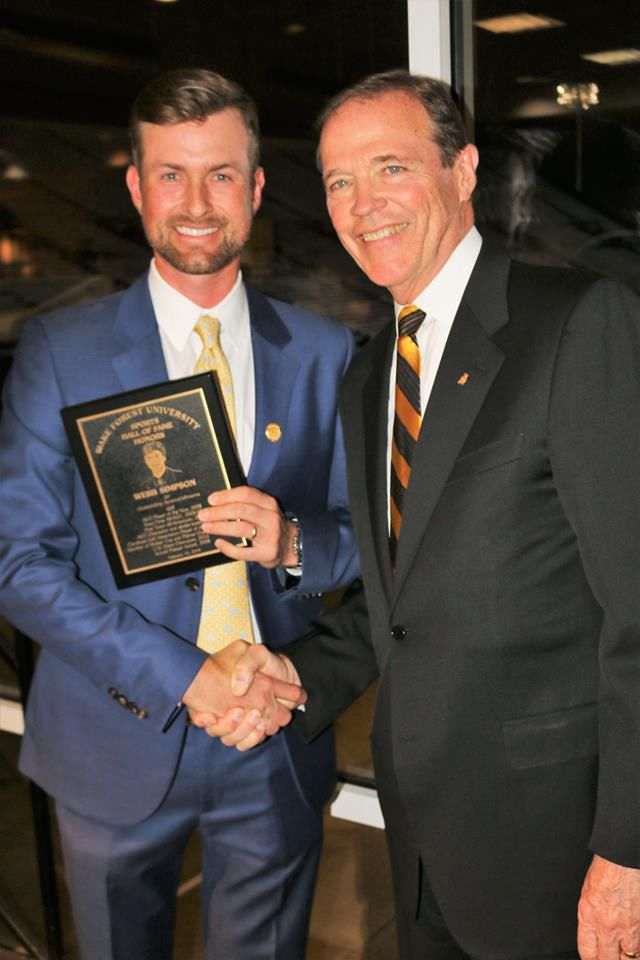 4c040506e0f8 Webb Simpson (left) and Athletics Director Ron Wellman of Wake Forest shake  hands Friday night at a dinner at Bridger Field House.