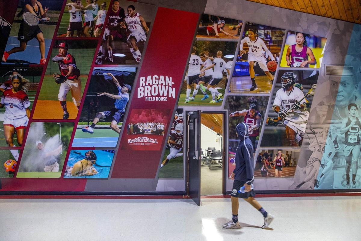 Guilford College renovated lobby features athletics photos