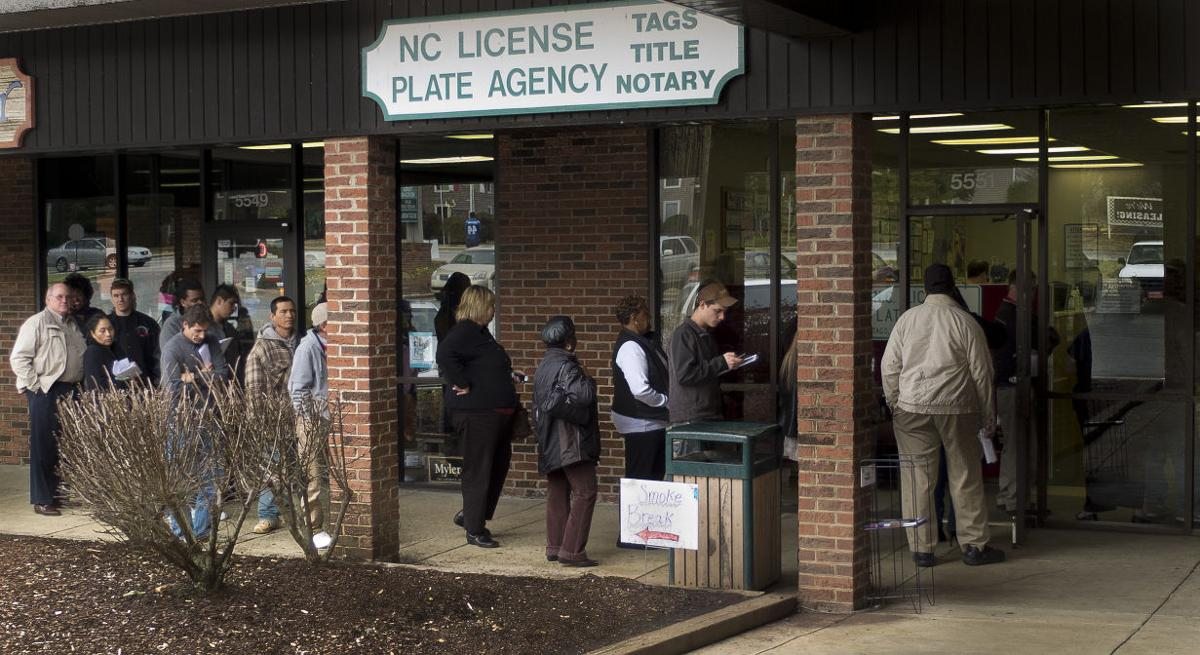 Crowded License Plate Offices Will Stay Packed A While Longer