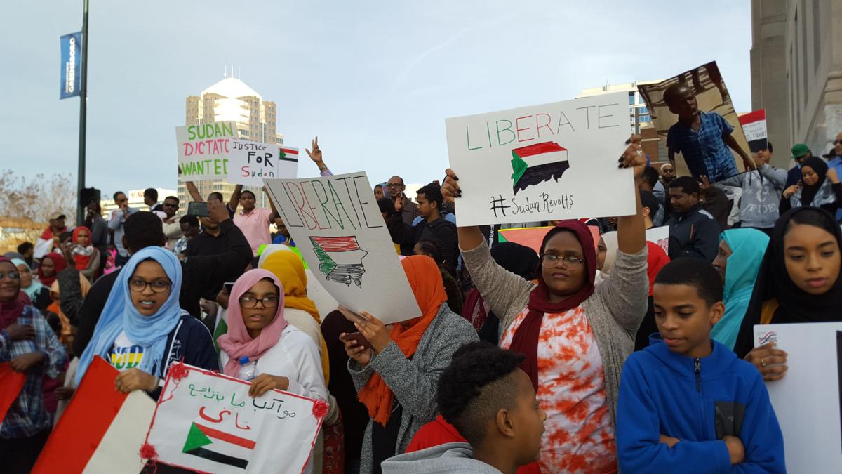 group protests sudanese leadership in downtown greensboro