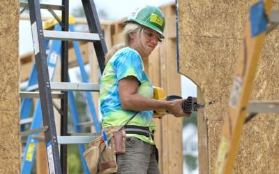 Volunteers from the Wyndham Championship work with Habitat for Humanity helps build house donated by Wyndham golf tournament (copy)