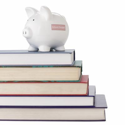 Piggy bank on school books