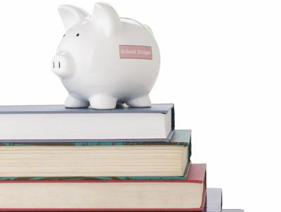 Piggy bank on school books FOR WEB