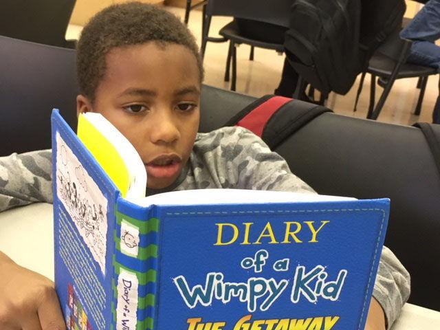 nonprofit Josiah Artis reading at tutoring.jpg