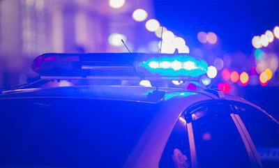 Police cruiser lightbar at night