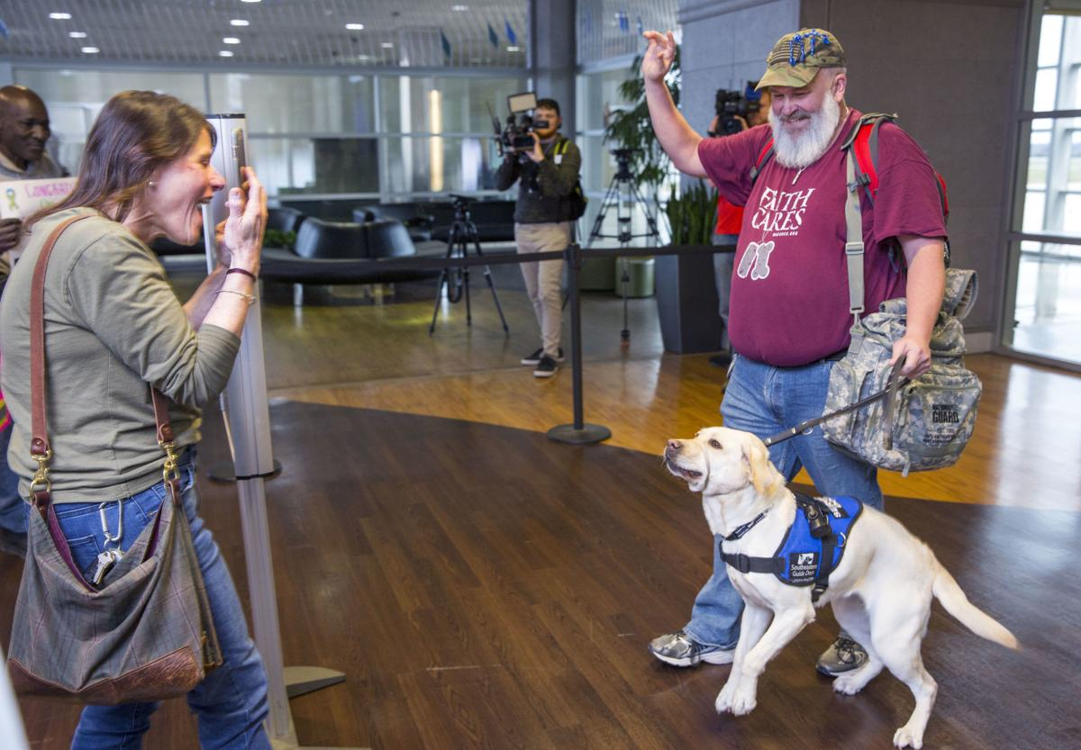 Army veteran returns home with new service dog
