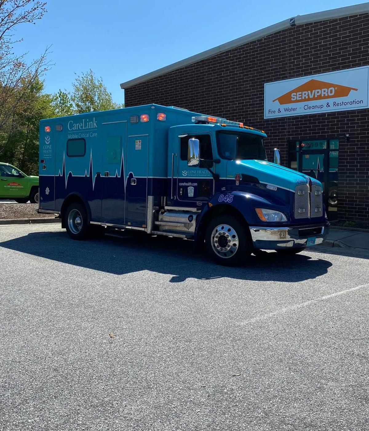 SERVPRO Truck, Logo & Cone Health Ambulence.jpg