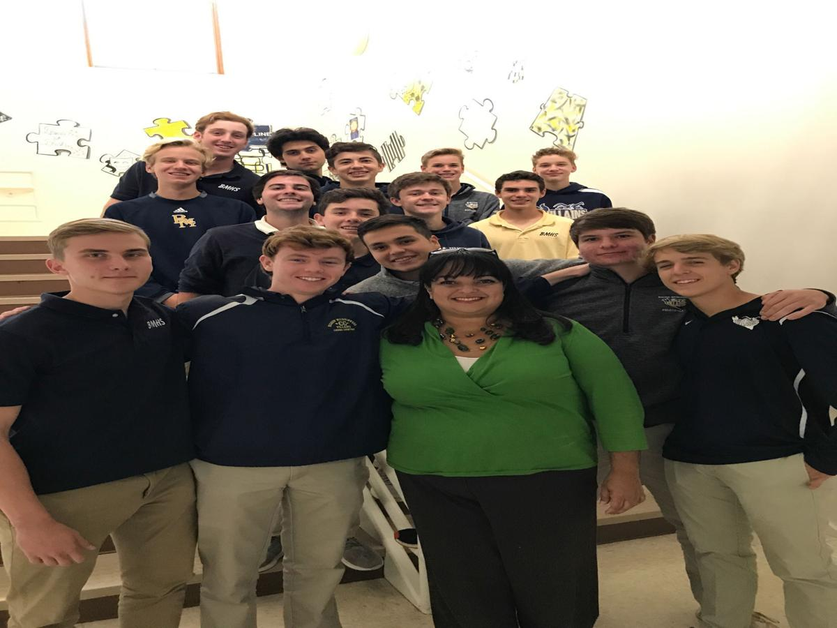 Monique Ferrelle visits with the Bishop McGuinness Catholic High School Roses Club