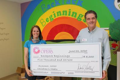 Greensboro Opera donates to Backpack Beginnings