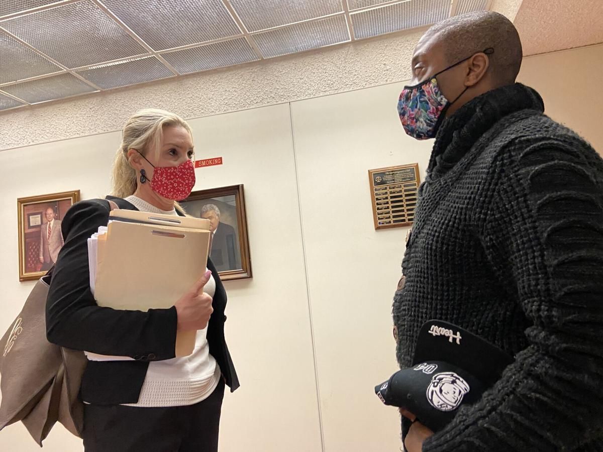 Ashley Cannon (left) speaks with her client, Jermaine Sanders, outside of the courtroom on Tuesday in Statesville.