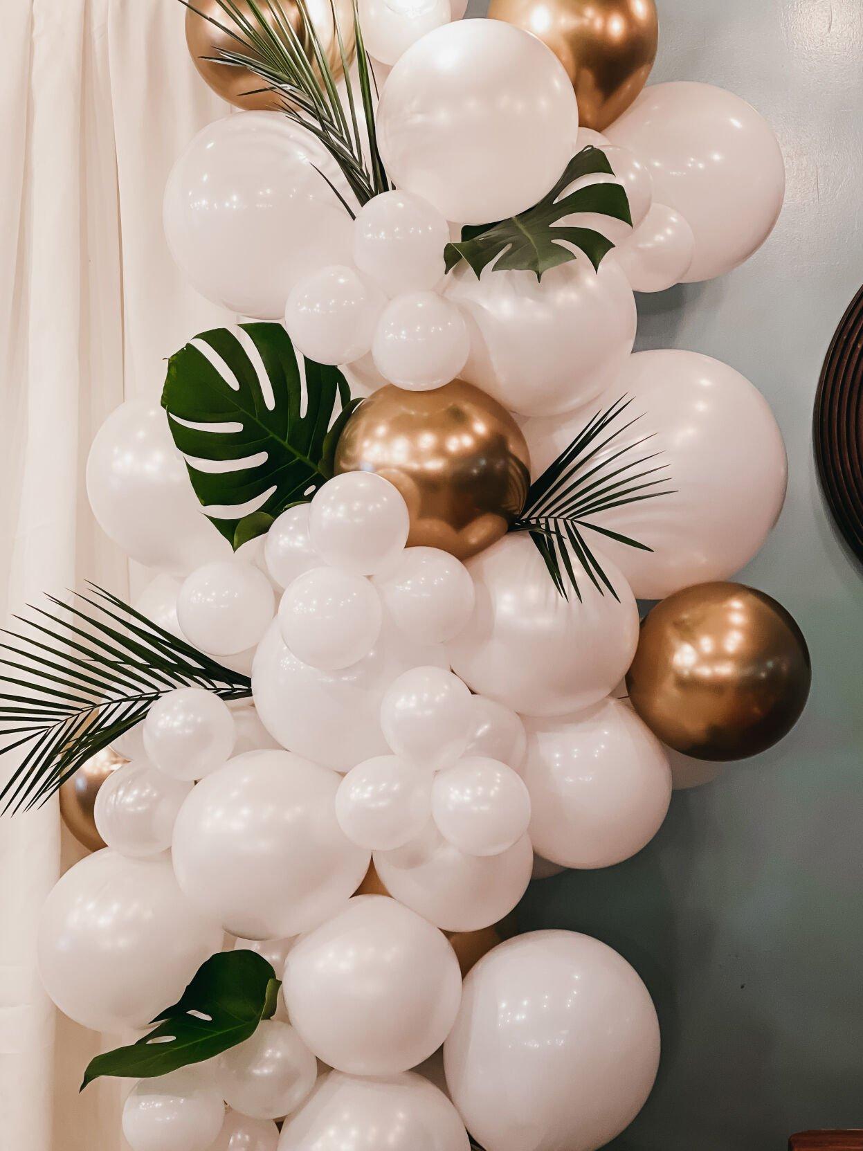 Grey mixes balloons and the tropics for his display