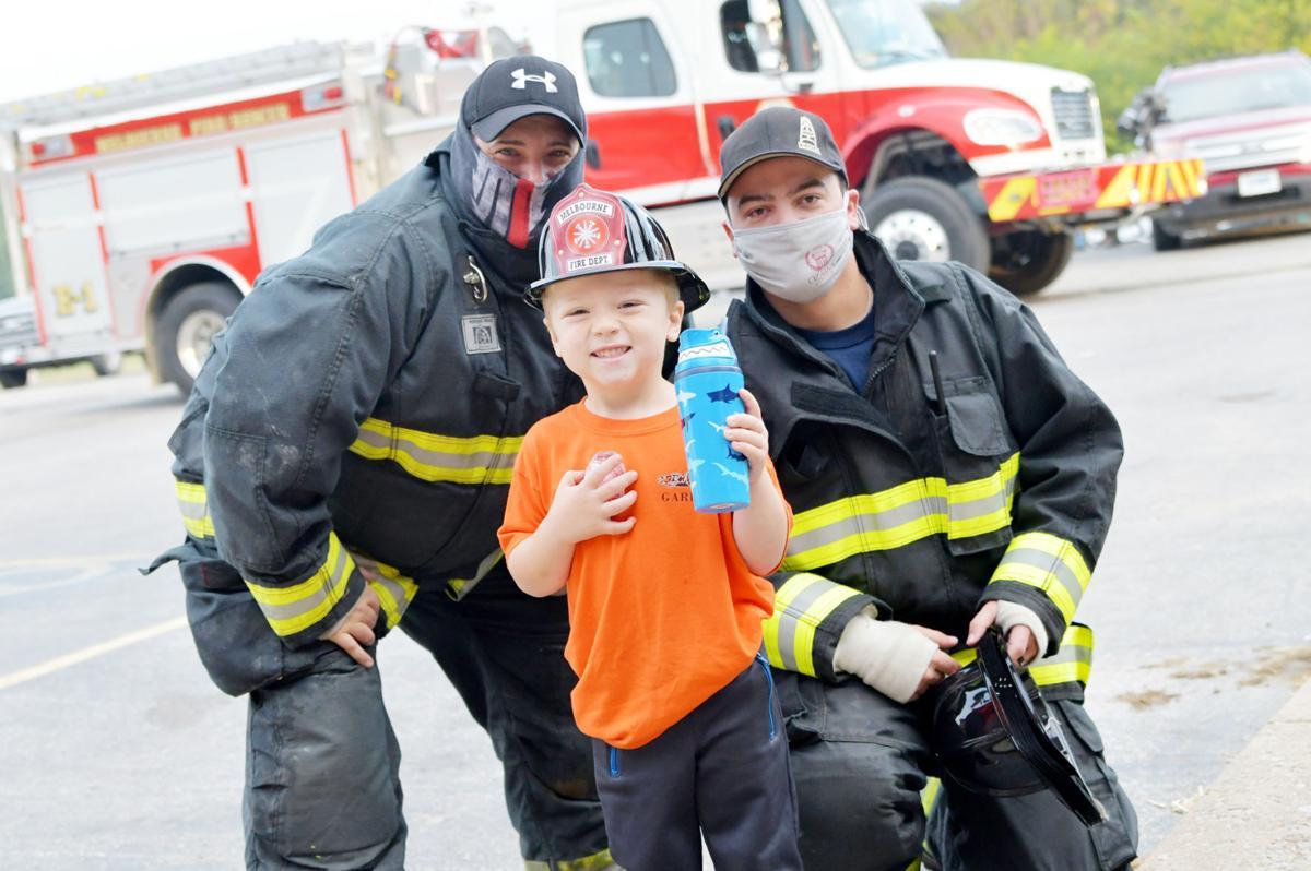 Child and firemen photo