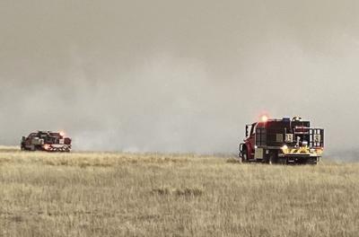 Brush fire trucks arrive on scene Sunday evening