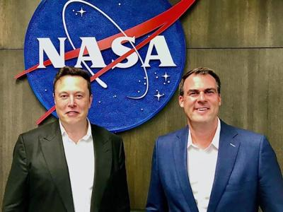 Gov. Kevin Stitt pictured with Tesla CEO Elon Musk