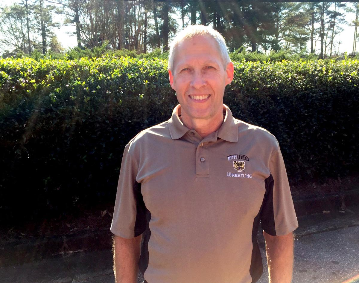 Gwinnett school board honors longtime Collins Hill wrestling coach Cliff Ramos