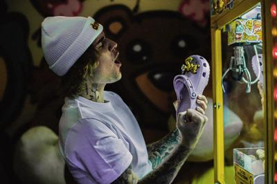 Justin Bieber and Crocs are collaborating again, pairing clogs and socks