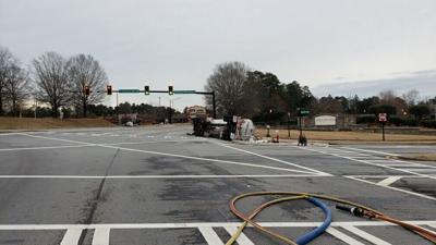 Overturned gas tanker truck has Hamilton Mill Rd. shut down at Braselton Highway