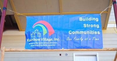 Rainbow Village sign