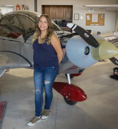 Maria with Billys plane.jpg