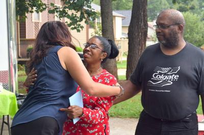 Lawrenceville family celebrates completion of home ownership program