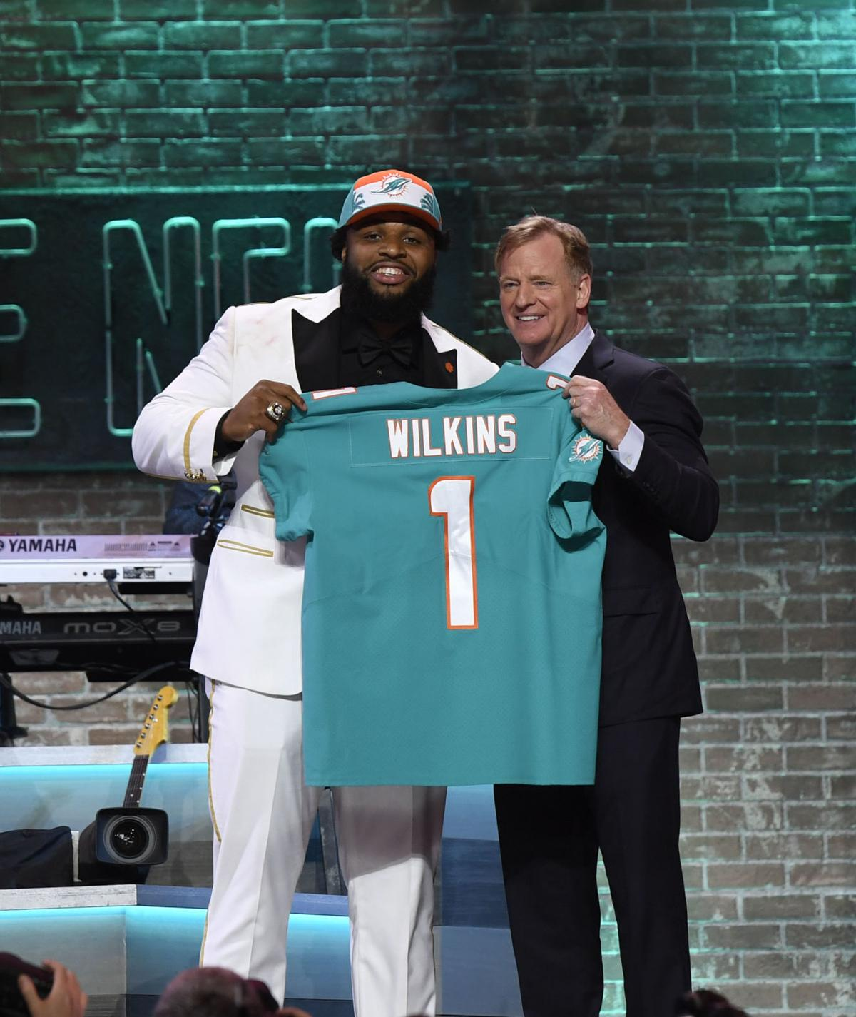 1c401ca036a ... USA  Christian Wilkins (Clemson) is selected as the number thirteen  overall pick to the Miami Dolphins and poses for a photo with NFL  commissioner Roger ...