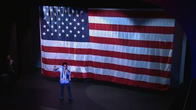 Mark Pitt Elvis in front of flag.jpg
