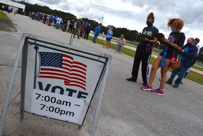 Voters waiting in line at Gwinnett Fairgrounds on first day of early voting for 2020 general election.jpeg