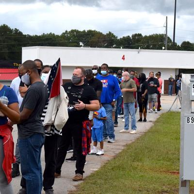 Voters in line at the Gwinnett County Fairgrounds on the first day of early voting for 2020 general election.jpeg