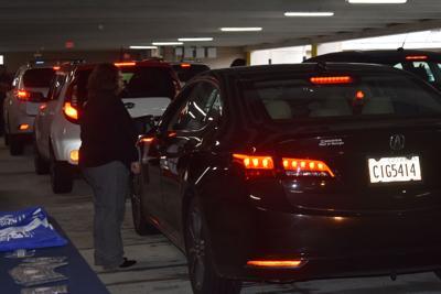 PHOTOS: Hundreds of cars line up outside Infinite Energy Center for drive-thru employment fair