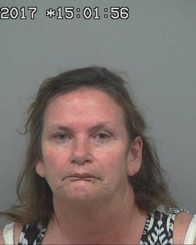 Lilburn woman accused of shooting stepfather