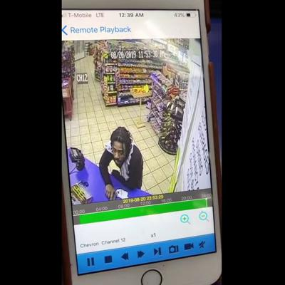 WATCH: Man calmly robs Snellville Chevron with handgun