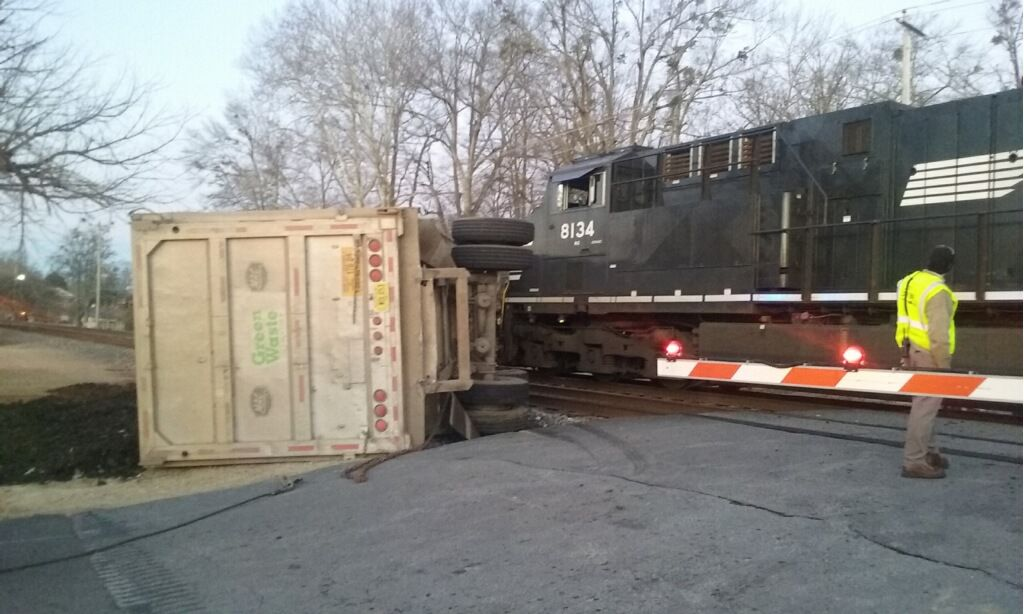 Train crashes into tractor-trailer in downtown Buford