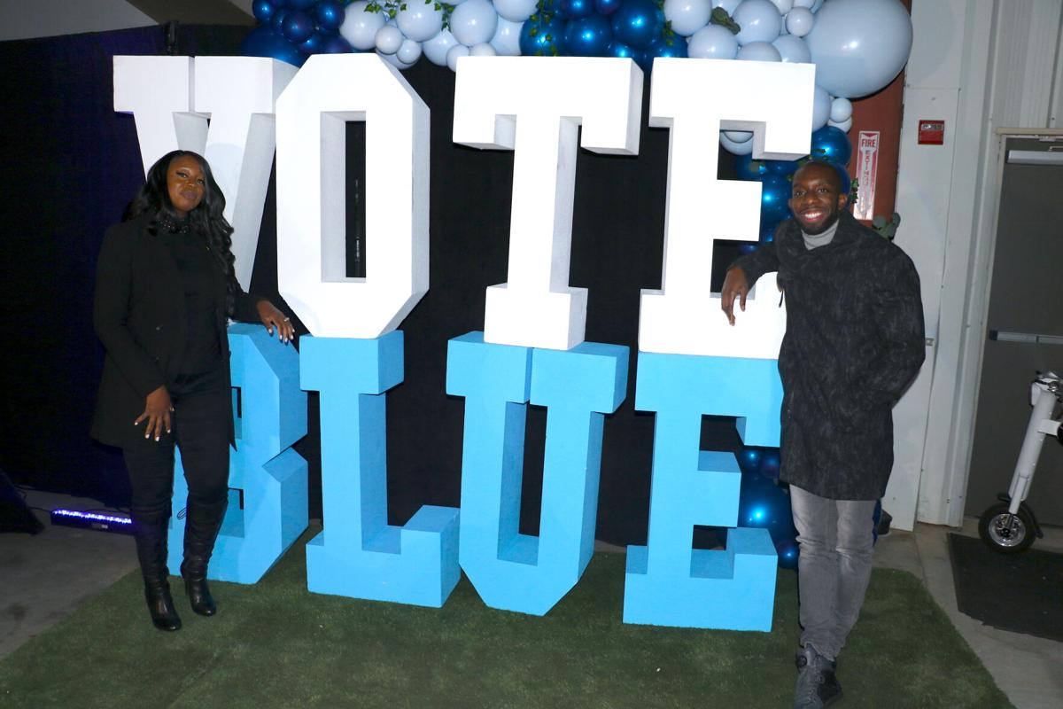 Nicole Love Hendrickson and Everton Blair with Vote Blue sign.jpeg