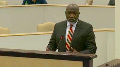 Clay Hunter addressing school board