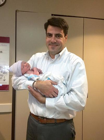 Chuck Efstration holding son.jpg