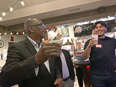 Newton celebrating mayoral win.jpg