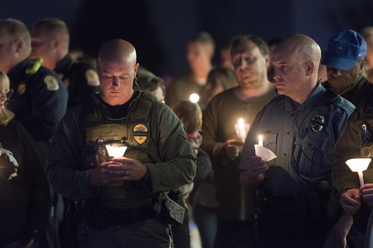 Vigil for slain Gwinnett officer draws hundreds