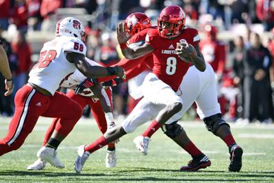 College Football Roundup Jackson Scores Four As Louisville Blasts