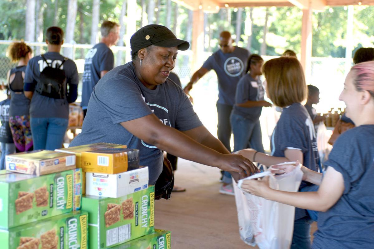 Tull-Gwinnett YMCA packs 900 food bags for needy children