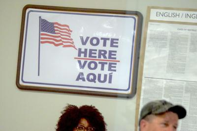 Vote Here Vote Aqui sign