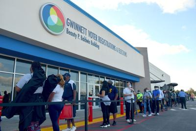 Gwinnett Counter voters in front of county elections office on first day of early voting for 2020 general election.jpeg
