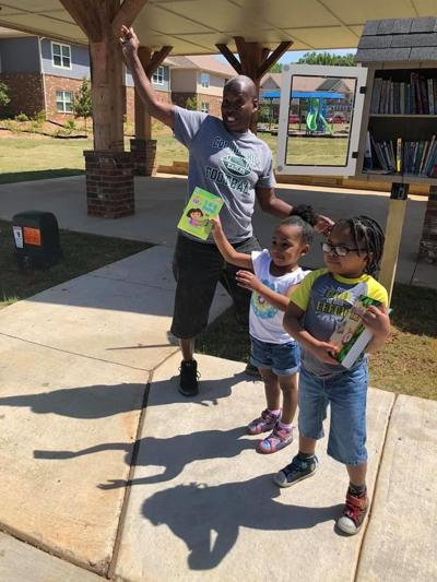 PHOTOS: Archer High School student installs libraries in Lawrenceville for Eagle Scout Project