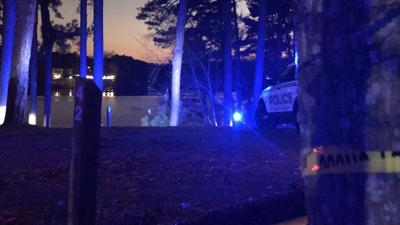 Gwinnett police say man hijacked car, shot at officers before crashing into Lake Lanier, where he died