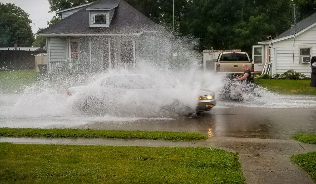 Heavy downpours cause street flooding