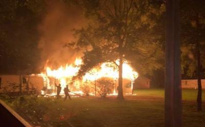 Investigators say fatal fire began outside home