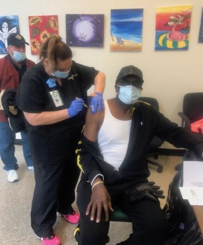 'The will to live' -- seniors step forward to take vaccine