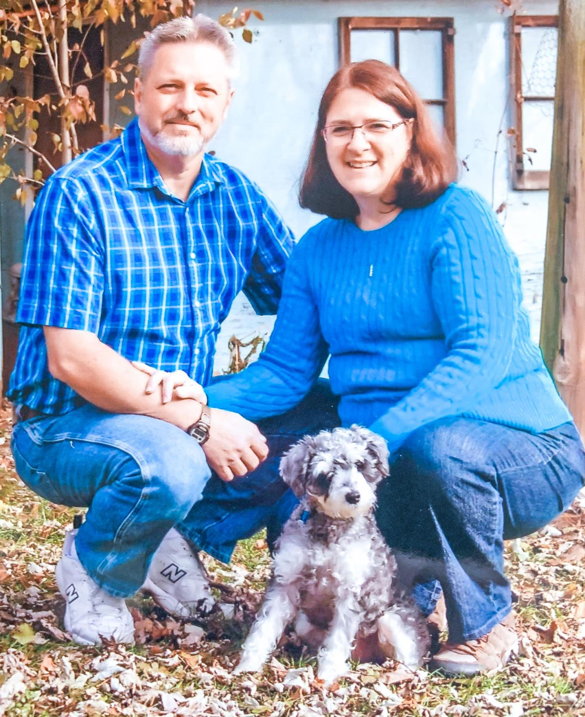 Allan and Melanie Meck with their dog Bentley.