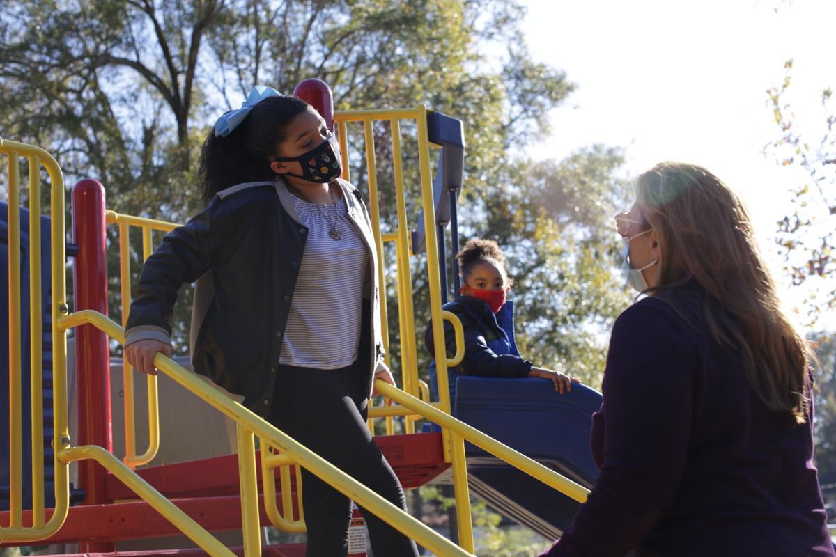 WM Mayor Staci Mitchell speaks to child on Gator Park playground.JPG