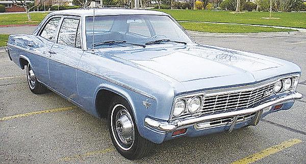 Turquoise 1966 Chevrolet Belair 4-door